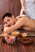 Man Receiving Lastone Therapy In Spa