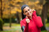 Successful Female Runner With Earphones