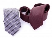 Brown and grey ties on white background isolated