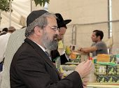 JERUSALEM, ISRAEL - SEPTEMBER 18, 2013: The religious Jew in a black skullcap carefully chooses ritu