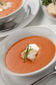 pic of lobster tail  - Two bowls of lobster bisque garnished with slice of lobster tail cream and fresh tarragon - JPG