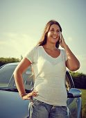Young Driver Woman On The Phone By Car