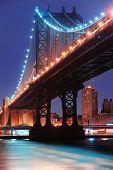 New York City Manhattan Bridge closeup with downtown skyline over East River.