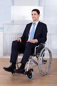Confident Businessman Sitting On Wheelchair