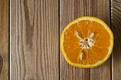Cut Orange From Above On Wood