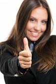 Beautiful young businesswoman portrait thumbs up