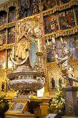 MADRID, SPAIN - MAY 28, 2014: Golden altar in Santa Maria la Real de La Almudena cathedral, Madrid,