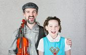 Happy Irish Musician With Child And Fiddle