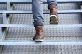 Man Walking Up Stairs In Boots