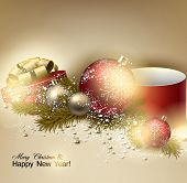 Beautiful Christmas background with red and golden balls.  Golden Xmas baubles, gifts and fir branch