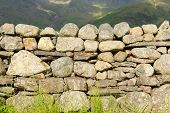 Dry stone wall with no mortar from north of England in the Lake District National Park Cumbria