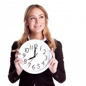 Portrait of happy smiling business woman holding in hands big clock isolated on white background, re