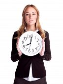 Portrait of serious business woman holding in hands big clock isolated on white background, eight o'