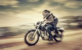 Two happy people riding on motorcycle, slow motion effect, grunge style photo, romantic relationship