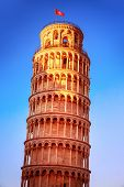 Leaning tower of Pisa on blue sky background, Europe, Italy, ancient medieval architecture, famous E