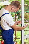 Man During Window Frame Reparation