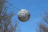 London - April 5. Pierced Aluminium Spheres Hanging Across Pathway On April 5, 2014, The Opening Day