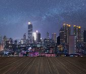 City night scene with wooden ground.