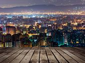 City night scene in Taipei, Taiwan. Focus on wooden floor.