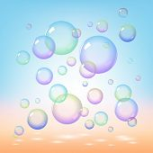 Soap bubbles on blue background
