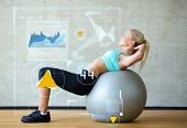 fitness, sport, training, future technology and lifestyle concept - smiling woman with exercise ball