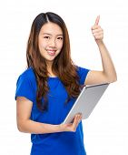 Woman hold digital tablet and thumb up