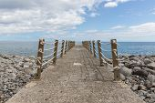 Concrete Jetty And Iron Fence With Ropes