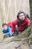 Male hikers trekking in forest