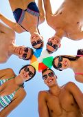 friendship, happiness, summer vacation, holidays and people concept - group of smiling friends weari