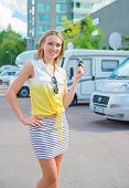 picture of campervan  - Beautiful young woman offers campervans at shop - JPG