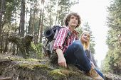 Young hiking couple relaxing in forest