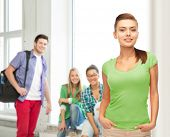 education and school concept - smiling young woman in blank green t-shirt
