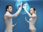 future, technology, business, education and people concept - man and woman working with globe hologr