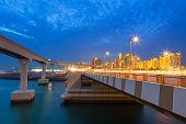 Bridge to the Palm Jumeirah island in Dubai at night, UAE