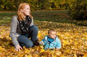 Indian Summer: Young Woman With Her Baby In Autumn. Family Concept For Single Parent.