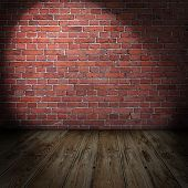 picture of stonewalled  - Blank grungy stonewall with spotlights and wooden floor - JPG