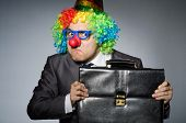 Clown businessman in funny concept
