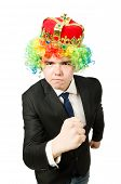 Funny businessman with crown and boxing gloves