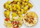 Tasty Camembert Cheese With Roasted Potatoes And Vegetable