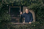 Senior Man With A Gun Protecting Property