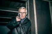 Dangerous Senior Aiming A Gun