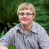 Portrait Of Handicapped Boy Wearing Glasses.