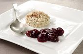 Porridge With Cherry On A Plate
