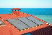picture of solar battery  - Solar system on the red house roof - JPG