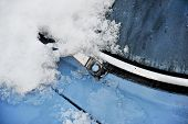 stock photo of wiper  - Detail shot with an old car windshield wiper covered in snow - JPG