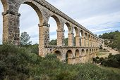 picture of aqueduct  - view of the roman aqueduct Pont del Diable Tarragona Spain - JPG