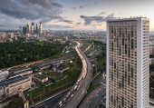 MOSCOW, RUSSIA - SEP 16, 2014: House on Begovaya with traffic on The Third Ring Road, railway, construction of business center