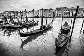 Gondola Moored At Dock In Venice