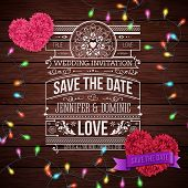 Wedding Invitation Design on Wooden Background