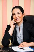 Portrait Of  Business Woman Calling By Telephone